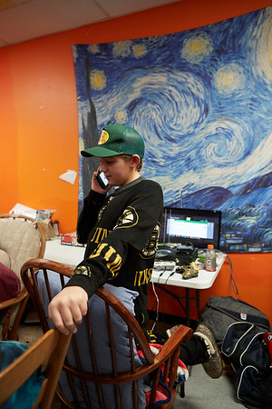 Benjamin Graham takes a break and helps a friend continue their rocking at the 21st Annual Rock-A-Thon to help feed those in need at the Teen Center in Gloucester, Saturday, January 13, 2018. Jared Charney / Photo