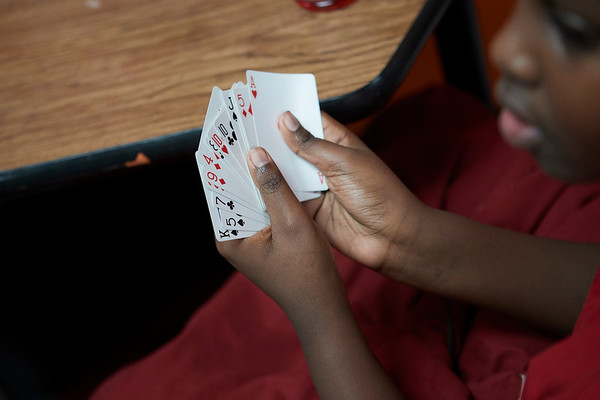 Nicholas Koros plays cards during the 21st Annual Rock-A-Thon to help feed those in need at the Teen Center in Gloucester, Saturday, January 13, 2018. Jared Charney / Photo