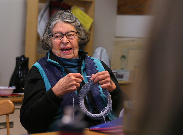 "MIKE SPRINGER/Staff photo   <br /> Patricia Weston enjoys the conversation while knitting a cowl during a ""Which Craft?"" needlework circle Monday at the Rockport Public Library. The circle, which meets every Monday from 11 a.m. to 1 p.m., is open to anyone interested in various forms of needlecraft, including knitting, crocheting, quilting and embroidering.<br /> 01/08/2018"