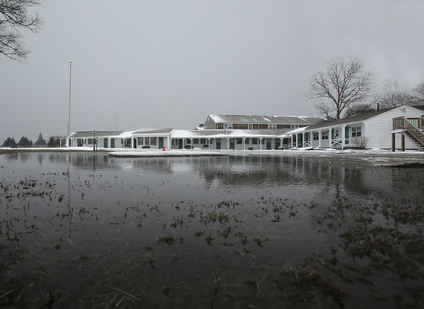 MIKE SPRINGER/Staff photo<br /> Salt water floods the parking lot of Shea's Riverside Inn and Motel in Essex Tuesday morning, following an astronomical high tide.<br /> 01/30/2018