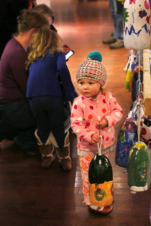 MIKE SPRINGER/Staff photo<br /> Two-year-old Willa Muise of Gloucester holds a buoy at the 10th annual Buoy Auction for Art Haven on Friday at Cruiseport Gloucester.<br /> 01/26/2018