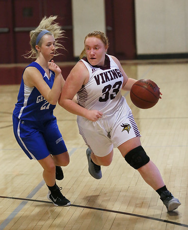 MIKE SPRINGER/Staff photo<br /> Rockport's Lauren Ryan drives the ball around Emma Dunlevy of Georgetown during varsity basketball action Monday in Rockport.<br /> 01/15/2018