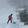 MIKE SPRINGER/Staff photo<br /> Even Ashe shovels snow from the sidewalk of his house on Madison Avenue during the storm Thursday in Gloucester.<br /> 01/04/2018