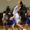 MIKE SPRINGER/Staff photo<br /> Rockport's Kylie Schrock towers over Nicole Donnelly of Georgetown as she goes up for a basket Monday during varsity basketball action in Rockport.<br /> 01/15/2018