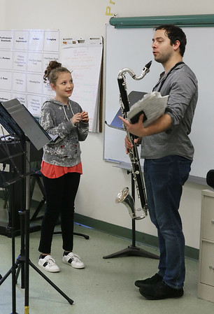 MIKE SPRINGER/Staff photo<br /> Fifth-grader Hannah Sherlock talks with bass clarinetist Andrew Koeppe of the Akropolis Reed Quintet following a performance Thursday at Veterans Memorial Elementary School.<br /> 01/25/2018