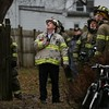 MIKE SPRINGER/Staff photo<br /> Deputy Fire Chief Stephen Aiello looks up at a badly damaged house at 33 Grove Street in Gloucester after firefighters put out a fire Tuesday morning.<br /> 01/23/2018 ORG XMIT: 180123_SN_MSP_FIRE [[MER1801231415033508]]