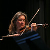 MIKE SPRINGER/Staff photo   <br /> Violinist Susanne Powers of the Cape Ann Symphony performs Wednesday during an educational presentation for fourth and fifth graders at Manchester Memorial School. Four musicians from the orchestra performed for the children and explained their role in the orchestra.<br /> 01/10/2018