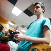 (L-R) Nicholas Koros & Frankie DeSisto (on a 10 minute break to stretch out his legs) play a video game at the 21st Annual Rock-A-Thon to help feed those in need at the Teen Center in Gloucester, Saturday, January 13, 2018. Jared Charney / Photo