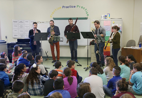 MIKE SPRINGER/Staff photo<br /> The Akropolis Reed Quintet performs Thursday for students at Veterans Elementary School in Gloucester. From left are Tim Gocklin, oboe; Matt Landry, saxophone; Ryan Reynolds, bassoon; Andrew Koeppe, bass clarinet; and Kari Landry, clarinet. Founded in 2009 at the University of Michigan, the Akropolis Reed Quintet is in residence on Cape Ann this week under the sponsorship of Rockport Music. The musicians are also visiting West Parish Elementary and Rockport middle and high schools. A free community concert was given Wednesday evening at the Shalin Liu Performance Center.<br /> 01/25/2018