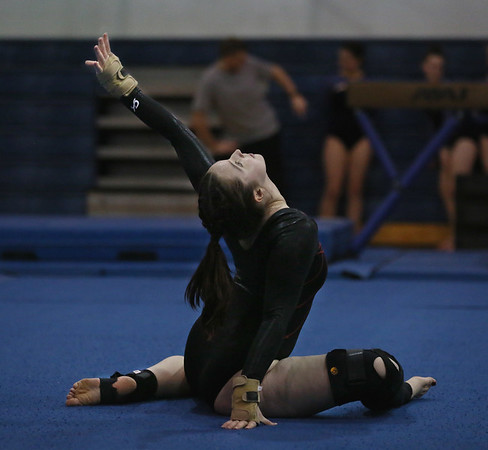 MIKE SPRINGER/Staff photo<br /> Lucy Platt of Ipswich competes in the floor exercise for the Gloucester-Ipswich team during a three-school meet Wednesday at Essex Agricultural and Technical High School in Danvers.<br /> 01/24/2018