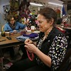 MIKE SPRINGER/Staff photo<br /> Laurie Hunt, owner of the Hooked knitting shop in Essex, and Stephanie Kassabian, left, of Hamilton knit together during an open knitting gathering Monday at Hooked. The shop has an open knitting circle every Saturday, Sunday, Monday and Tuesday from 10 a.m. to 6 p.m.<br /> 01/22/2018 ORG XMIT: 180122_SN_MSP_KNITTING [[MER1801221725453380]]