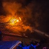 Desi Smith Photo.   Flames rip through the roof of a home at 12 Rockport Rd owned by Richard Mann, Monday night at Long Beach.    January 8,2018 [[MER1801082115051057]]