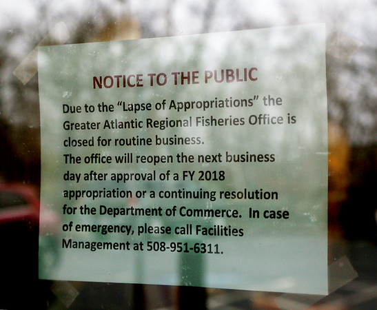 MIKE SPRINGER/Staff photo<br /> A sign on the door of the National Oceanic and Atmospheric Administration (NOAA) office at 55 Great Republic Drive in Gloucester explains that the office is closed Monday due to the government shutdown.<br /> 01/22/2018