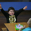 MIKE SPRINGER/Staff photo<br /> First-grader Thomas Patrican celebrates a goal while playing a game of tabletop hockey with his classmate William George during the Cape Ann YMCA's after-school program Friday at East Gloucester Elementary School.<br /> 01/19/2018