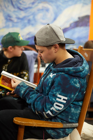 Camryn Moody leafs through a magazine to help pass the time at the 21st Annual Rock-A-Thon to help feed those in need at the Teen Center in Gloucester, Saturday, January 13, 2018. Jared Charney / Photo