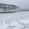 Kelsey Bode/Staff photo/Storm surge cracked the frozen basin behind the Beacon Marine Basin building off East Main Street and flooded the shipyeard next door.