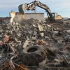 MIKE SPRINGER/Staff photo   <br /> A worker with New Hampshire Demolition uses an excavator Wednesday to demolish a building on the Gloucester waterfront, next to Steve Connolly Seafood.<br /> 01/03/2017