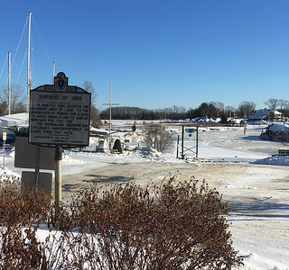 """ANDREA HOLBROOK/Staff photo/A tercentenary sign sits at the entrance of Essex's Town Landing  off Main Street. The  town gave the """"Shipyard of 1968"""" to the residents """"of Ipswich to build vessels and employ workmen to that end."""" It has been a shipyard ever since."""
