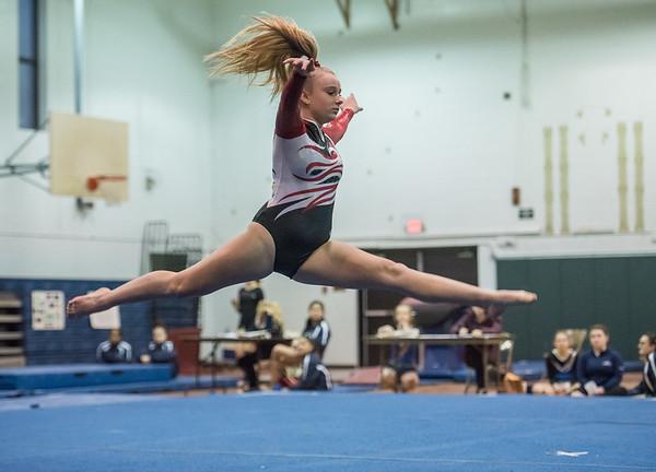 AMANDA SABGA/Staff photo<br /> <br /> Gloucester High School's Aubrey O'Flynn performs her floor routine during a gymnastics meet at Essex Technical School. <br /> <br /> 1/30/19