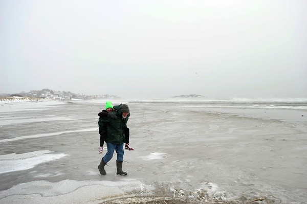 John and Lindy Almeida have fun on the arctic landscape that is Good Harbor beach on Monday MLK Day January 21, 2019.  Photo by Joseph PREZIOSO [[MER1901211340580904]]