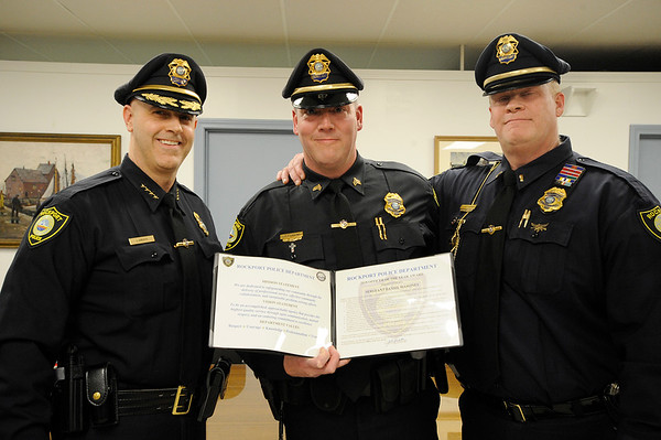 Sargent Dan Mahoney was awarded Rockport's first officer of the year award, he stands with Chief John Horvath and Lt. Mark Schmink for a photo during a selectman meeting where Officer Dan Mahoney was promoted to Sargent at Rockport Town Hall on Tuesday January 8, 2019.  Photo by Joseph PREZIOSO