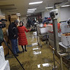 TIM JEAN/Staff photo<br /> <br /> China Central Televison correspondent Zhu Xili, center, and camera operator Mu Lyu, left, talks with Vince Mortillaro, owner of Mortillaro Lobster Company in Gloucester. Mortillaro demonstrated the process of how they ship live lobsters to China.    1/31/19