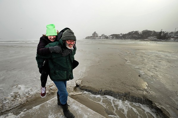 John and Lindy Almeida have fun on the arctic landscape that is Good Harbor beach on Monday MLK Day January 21, 2019.  Photo by Joseph PREZIOSO [[MER1901211340560903]]