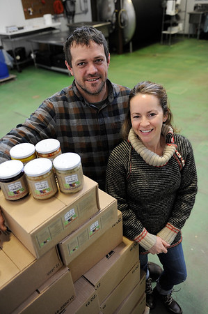 TIM JEAN/Staff photo<br /> <br /> Kristen and Dylan L'Abbe-Lindquistowners of Pigeon Cove Ferments stand in their canning and fermenting warehouse in Gloucester. 1/29/19
