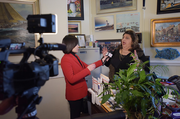 TIM JEAN/Staff photo<br /> <br /> Gloucester Mayor Sefatia Romeo Theken, right, talks with China Central Televison correspondent Zhu Xili, as camera operator Mu Lyu films her for a TV show on lobsters.     1/31/19