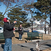 "AMANDA SABGA/Staff photo<br /> <br /> Local author Andrew Joyce feeds seagulls at Captain Solomon Jacobs Park in downtown Gloucester Wednesday morning. Joyce says ""I try to be democratic [with the bread] especially to the guys in the back."" <br /> <br /> 1/30/19"