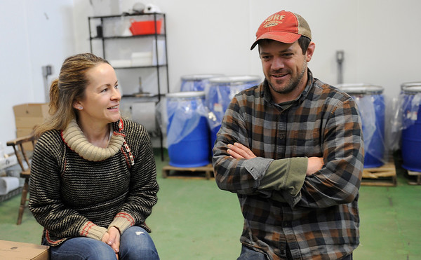 TIM JEAN/Staff photo<br /> <br /> Kristen and Dylan L'Abbe-Lindquist	owners of Pigeon Cove Ferments talk about their canning and fermenting process in their warehouse in Gloucester. 1/29/19