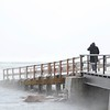 A man makes his way over the ice bridge to Good Harbor Beach in Gloucester on Monday MLK Day January 21, 2019.  Photo by Joseph PREZIOSO [[MER1901211341110909]]