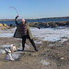TIM JEAN/Staff photo<br /> <br /> Emily Richey-Smith, of Gloucester, throws a ball for her dog, Maya, a 10 month old yellow lab at Stage Fort Park in Gloucester.      1/31/19