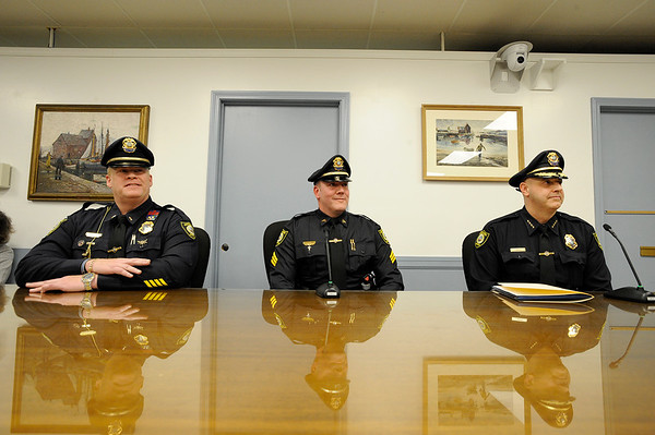 Officer Dan Mahoney, center, sits with Lt. Mark Schmink and Chief John Horvath during a selectman meeting where Officer Dan Mahoney was promoted to Sargent at Rockport Town Hall on Tuesday January 8, 2019.  Photo by Joseph PREZIOSO