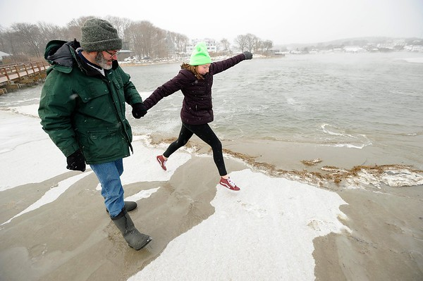 John and Lindy Almeida have fun on the arctic landscape that is Good Harbor beach on Monday MLK Day January 21, 2019.  Photo by Joseph PREZIOSO [[MER1901211341010905]]