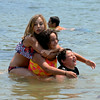RYAN HUTTON/ Staff photo.<br /> Stepsiblings Haylee Aberegg, 14, left, Nina Polsonetti, 10, center, and Cameron Aberegg, 10, all of Gloucester, goof around in Wonson Cove in Gloucester on Wednesday.