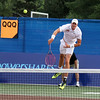 MARIA UMINSKI/GLOUCESTER DAILY TIMES John Isner of the Boston Lobsters watches his hit as it soars over the net during his match against Frank Dancevic of the Philadelphia Freedoms at the Manchester Athletic Club.
