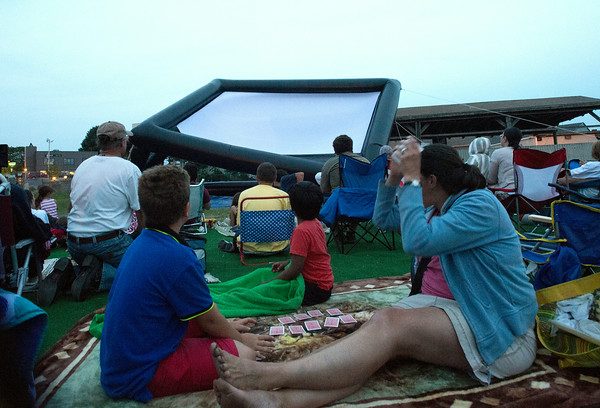 "DESI SMITH/Staff photo.   Nora Priest and her son Josh 9, of Gloucester, and others, react as the inflatable screen gets blown over, while waiting for the start of ""Back to the Future"" at the outdoor movie showing on I-4 C-2 property Wednesday night, as part of city-sponsored Summer Cinema Series. After a couple attemts to secure the large inflatable screen, the show did go on.   July 19,2014"