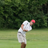 DESI SMITH/Staff photo.  Tyler Conigliary  takes a shot towards the green, during the 2014 Club Championship playoffs Sunday morning at Bass Rocks Golf Club.    July 20,2014