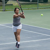 DESI SMITH/Staff photo. Gloria Lust-Phillips returns the ball in a doubles match with partner David Salah, against John Sperry and Nancy Gambal in the Bass Rocks Jerry Blitz Memorial Tennis Tournament held Saturday morning at Bass Rocks Tennis Courts.    July 26,2014