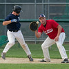 DESI SMITH/Staff photo.  Rockport's Drew Shairs keeps a Manchester base runner close to first base,Friday night at Evans Field in Rockport.  July 25,2014