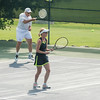 DESI SMITH/Staff photo.  Will Daly returns the ball in a doubles match with partner Tricia McInnis, against  Scott MacIntosh and Kathy Frick, in the Bass Rocks Jerry Blitz Memorial Tennis Tournament held Saturday morning at Bass Rocks Tennis Courts.    July 26,2014