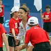 MARIA UMINSKI/GLOUCESTER DAILY TIMES Sharon Fichman of the Boston Lobsters high fives the ball boys and girls before the team's match against the Philadelphia Freedoms at the Manchester Athletic Club.
