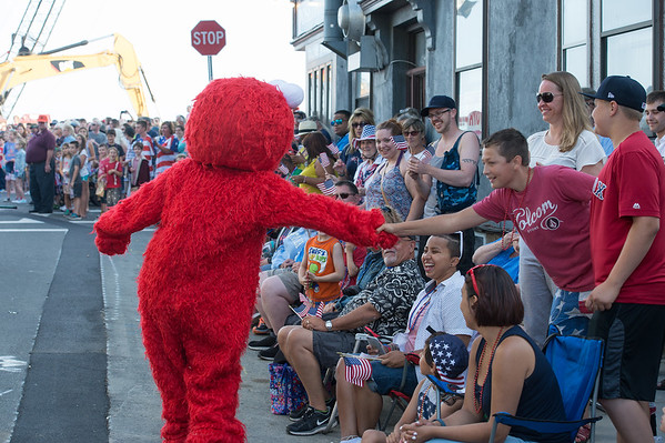 Desi Smith Photo.  Elmo greets spectators that line both sides of Centenial Ave along the parade route on Centenial Ave in the Fishtown Horribles Parade Sunday afternoon.     July 3,2016