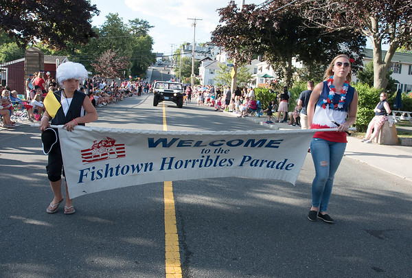 Desi Smith Photo.    Ella Tucker 9, left and Katlyn Burke lead the way down Centenial Ave carring the Fishtown Horribles Parade banner Sunday afternoon.     July 3,2016