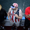 PAUL BILODEAU/Staff photo. A group of Veterans waiting to head out fishing dock on the stern of the Yankee Freedom prior to heading out to fish. Dave Marciano of Wicked Tuna and Tom Orrell of the Yankee Fleet hosted a fishing trip to benefit the Wounded Warrior Project.