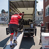 Desi Smith Photo.  Gary Knowles of Salem (back to) and Alex Lockhard of Lynn, from Wakefield Moving and Storage Inc, load plactic containers containing books and other school supplies that were packed by teachers and other staff members,on to a truck that will be transferred to the new West Parish School from St Ann's Wednesday afternoon.     July 22,2016