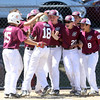 DAVID LE/Staff photo. Gloucester little leaguers mob Jack Viera after he hit a homer against Masco on Saturday morning. 7/2/16.