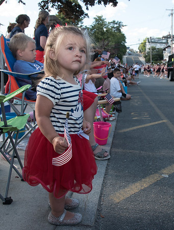 Desi Smith Photo.    Charlotte Elwell 2, of Gloucester, holds her flag as she looks on at the band that just past on Centenial Ave in the Fishtown Horribles Parade Sunday afternoon.     July 3,2016