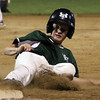 DAVID LE/Staff photo. Manchester-Essex pinch runner Connor Cunningham slides safely into third after advancing on a fielder's choice against Beverly in the District 15 Final on Thursday evening. 7/14/16.